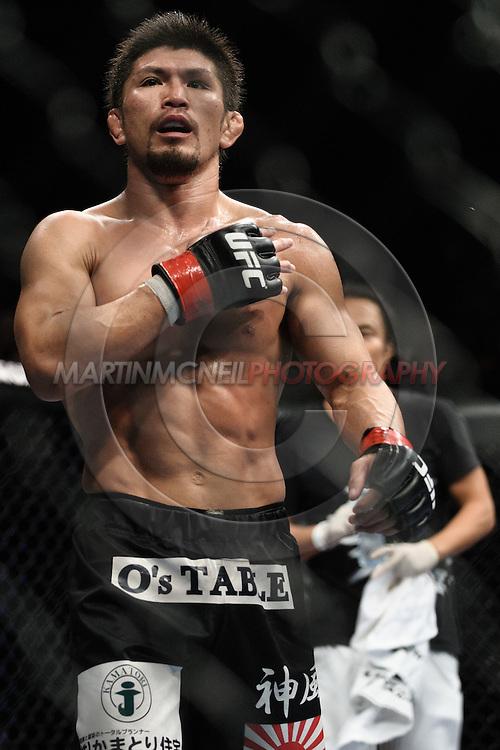 "BIRMINGHAM, ENGLAND, NOVEMBER 5, 2012: Michihiro Omigawa walks around the octagon during ""UFC 138: Munoz vs. Leben"" inside the National Indoor Arena in Birmingham, United Kingdom"
