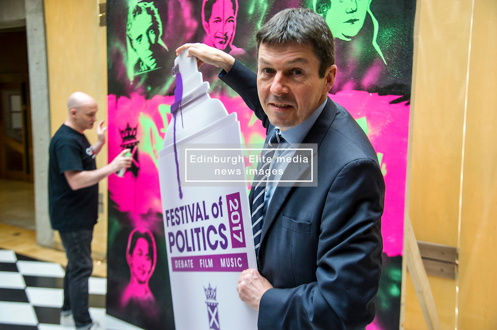 Pictured: Craig Robertson and Ken Macintosh<br /> Scottish Parliament Presiding Officer Ken Macintosh MSP today launched the 2017 Festival of Politics programme.  He was joined by street artist Craig Robertson as a 12ft-by-6ft work of art commissioned for this year's festival - which runs between October 19 and 21 - was unveiled<br />  <br /> Ger Harley   EEm 27 June  2017
