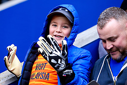 A Cardiff City fan looks on delighted to have been given a pair of Goalkeeping gloves by Neil Etheridge of Cardiff City - Mandatory by-line: Robbie Stephenson/JMP - 29/12/2018 - FOOTBALL - King Power Stadium - Leicester, England - Leicester City v Cardiff City - Premier League