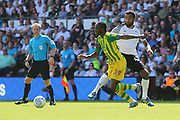 West Bromwich Albion midfielder Romaine Sawyers (19) gets away from Derby County midfielder Tom Huddlestone (44) during the EFL Sky Bet Championship match between Derby County and West Bromwich Albion at the Pride Park, Derby, England on 24 August 2019.