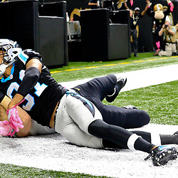 Oct 16, 2016; New Orleans, LA, USA; New Orleans Saints tight end Josh Hill (89) holds on to a touchdown catch as Carolina Panthers cornerback Zack Sanchez (31) defends during the fourth quarter of a game at the Mercedes-Benz Superdome. The Saints defeated the Panthers 41-38. Mandatory Credit: Derick E. Hingle-USA TODAY Sports
