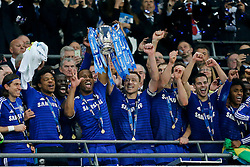 John Terry of Chelsea lifts  the League Cup trophy after winning the Capital One Cup Final - Photo mandatory by-line: Rogan Thomson/JMP - 07966 386802 - 01/03/2015 - SPORT - FOOTBALL - London, England - Wembley Stadium - Chelsea v Tottenham Hotspur - Capital One Cup Final.