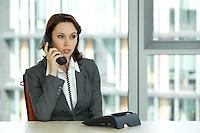 portrait of young confident caucasian businesswoman talking on phone