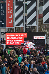 © Licensed to London News Pictures. 27/03/2018. London, UK. Campaigners from Avaaz drive a mobile ad truck which reads 'Russia can't host the World Cup while bombing Syrian kids' past Wembley Stadium as England prepare to play Italy. Photo credit: Rob Pinney/LNP