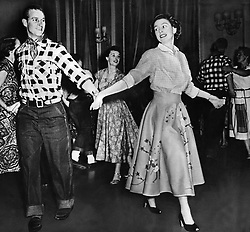 Oct. 18, 1951 - Ottawa, Canada - The elder daughter of King George VI and Queen Elizabeth, ELIZABETH WINDSOR (named Elizabeth II) became Queen at the age of 25, and has reigned through more than five decades of enormous social change and development. PICTURED: PRINCESS ELIZABETH with PRINCE PHILIP dancing country dances during a visit in Canada. (Credit Image: © Keystone Press Agency/Keystone USA via ZUMAPRESS.com)