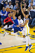 Golden State Warriors guard Shaun Livingston (34) defends LA Clippers guard C.J. Williams (9) at Oracle Arena in Oakland, Calif., on January 10, 2018. (Stan Olszewski/Special to S.F. Examiner)