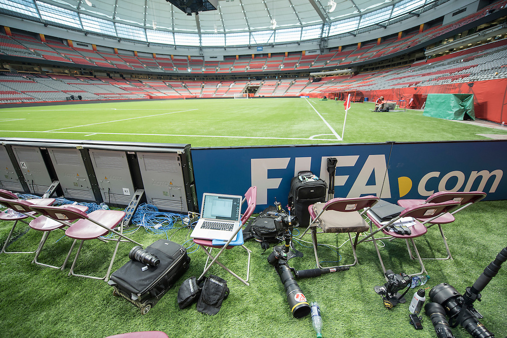 Photographer positions after the game at the 2015 women's World Cup Soccer in Vancouver during the first round action between USA and Nigeria.