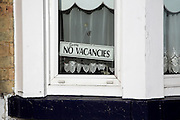 No vacancies sign in window. Seafront guest houses out of season, Lowestoft, Suffolk, England