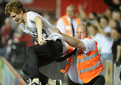 stewards struggle to contain fans in the stands.  - Photo mandatory by-line: Alex James/JMP - Tel: Mobile: 07966 386802 04/09/2013 - SPORT - FOOTBALL -  Ashton Gate - Bristol - Bristol City V Bristol Rovers - Johnstone Paint Trophy - First Round - Bristol Derby