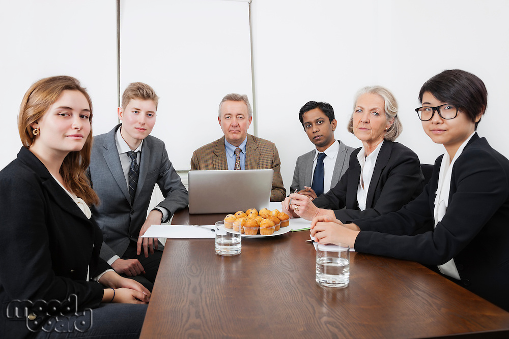Portrait of multiethnic professionals in meeting at conference room