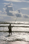Person fishing in the ocean