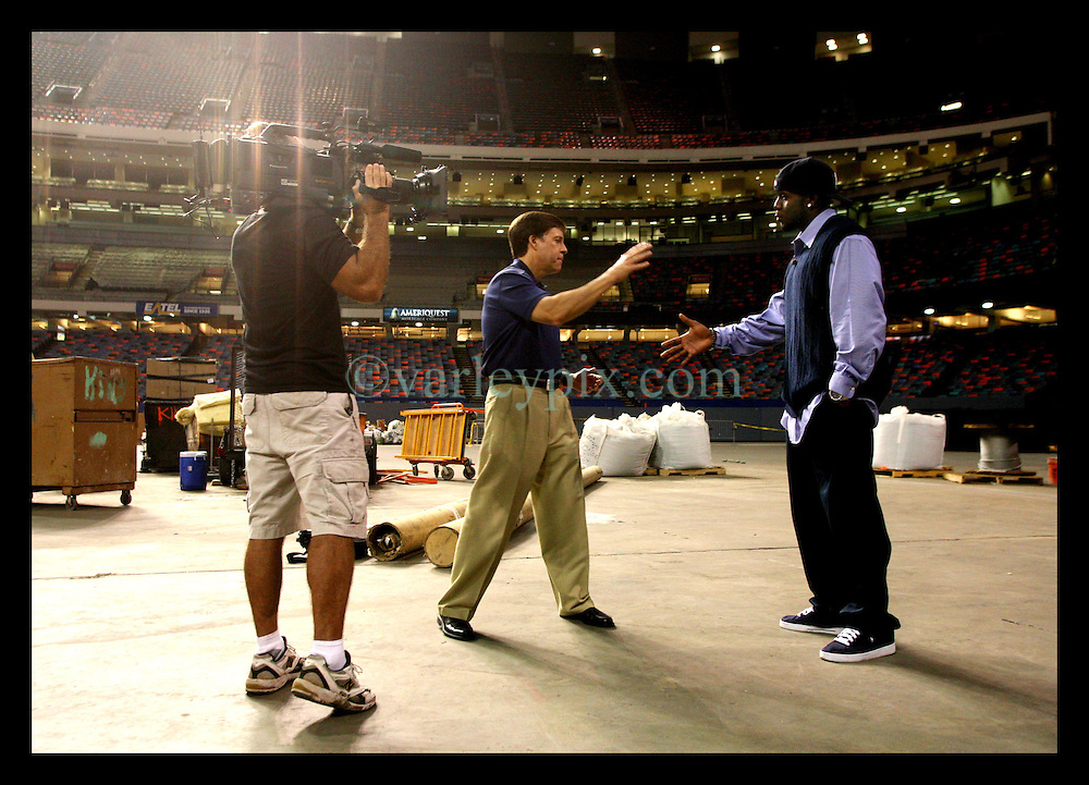 27 August 2006 - New Orleans - Louisiana. Reggie Bush - Superdome. Bush is interviewed by HBO's sportscaster Bob Costas. Bush, the New Orleans Saints record breaking new purchase at almost $62million takes a walk around the the 'pitch' area for the very first time. Almost a year ago to the day the Superdome started filling up with people seeking shelter from hurricane Katrina. The superstar running back was visibly moved as he toured the facility, still awaiting a new pitch ahead of its scheduled Sept 25th re-opening.