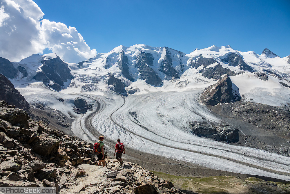 "From Diavolezza cable car station, admire tremendous views of the icy Bernina Range, in Switzerland, Europe. Above Pers Glacier rise Piz Palü (3900 m on left), Piz Zupò (3996 m), in the Swiss canton of Graubünden (or Grisons / Grigioni / Grischun). If not afraid of heights at Diavolezza, don't miss the magnificent hike to rocky Munt Pers (gaining 265 meters over just 4 km round trip). The Swiss valley of Engadine translates as the ""garden of the En (or Inn) River"" (Engadin in German, Engiadina in Romansh, Engadina in Italian) and is part of the Danube basin."