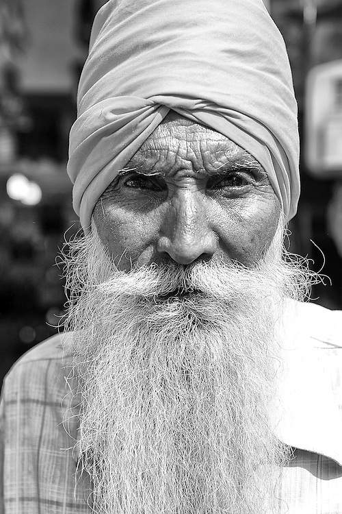 Black and white portrait of a Sikh Man in turban with long beard