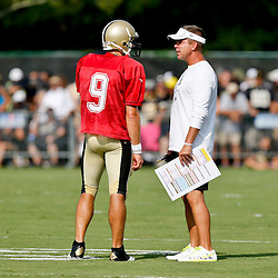 Aug 3, 2013; Metairie, LA, USA; New Orleans Saints head coach Sean Payton with quarterback Drew Brees (9) during a scrimmage at the team training facility. Mandatory Credit: Derick E. Hingle-USA TODAY Sports