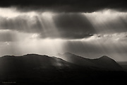 Crepuscular rays over the dark mountains of the Llyn Peninsula in North Wales