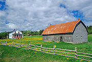 Barn, house and fence on Gaspe Peninsula<br /> Grosses-Roches<br /> Quebec<br /> Canada