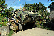 Australian and Malaysian soldiers patrol the Comora area of Dili, in an effort to prevent the continual Gang violence that plagues the area. East Timor 04/06/06