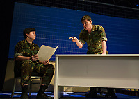 """Charles Purcell Capt. Matthew Markinson speaks with Ryan Witham Lt. Col. Nathan R. Jessup during dress rehearsal for """"A Few Good Men"""" with Gilford High School on Monday afternoon.  (Karen Bobotas/for the Laconia Daily Sun)"""
