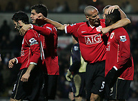 Photo: Paul Thomas.<br /> Blackburn Rovers v Manchester United. The Barclays Premiership. 11/11/2006.<br /> <br /> Man Utd's Rio Ferdinand (5) congratulates scorer Louis Saha (9).