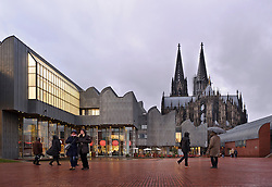 Cologne, Germany, Jan. 2012 -  The spires of the Cologne Dom Cathedral at right, tower over the Ludwig Museum at left, which houses a collection of modern art and includes works from PopArt, Abstract and Surrealism, and has one of the largest Picasso collections in Europe. It also features many works by Andy Warhol and Roy Lichtenstein. (Heinrich-Böll-Platz 50667 Cologne ; www.museum-ludwig.de ; 49 221-16875139). (Photo © Jock Fistick).