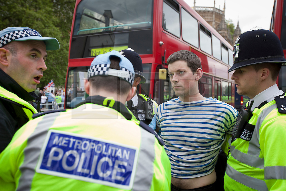 © Licensed to London News Pictures. 01/06/2013. London, UK. Supporters of Unite Against Fascism (UAF) are seen after being arrested in central London today after they broke through a police cordon to confront British National Party (BNP) supporters who were demonstrating in central London today (01/06/2013). The BNP protest was held in response to the killing of Drummer Lee Rigby, who died after an attack in Woolwich where religious extremism may have been the motive. Photo credit: Matt Cetti-Roberts/LNP