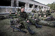 Young recruits rest in the surroundings of a dismantled Russian military base in the forests of Central Lithuania.