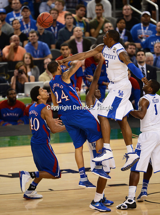 Apr 2, 2012; New Orleans, LA, USA; Kentucky Wildcats forward Terrence Jones (3) blocks a shot by Kansas Jayhawks guard Travis Releford (24) during the second half in the finals of the 2012 NCAA men's basketball Final Four at the Mercedes-Benz Superdome. Mandatory Credit: Derick E. Hingle-US PRESSWIRE