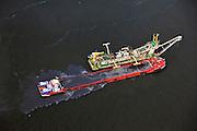 Nederland, Zuid-Holland, Gemeente Maassluis, 23-05-2011; Nieuwe Waterweg, baggerschip met lichter..A dregder dredging the Nieuwe Waterweg..luchtfoto (toeslag), aerial photo (additional fee required).copyright foto/photo Siebe Swart