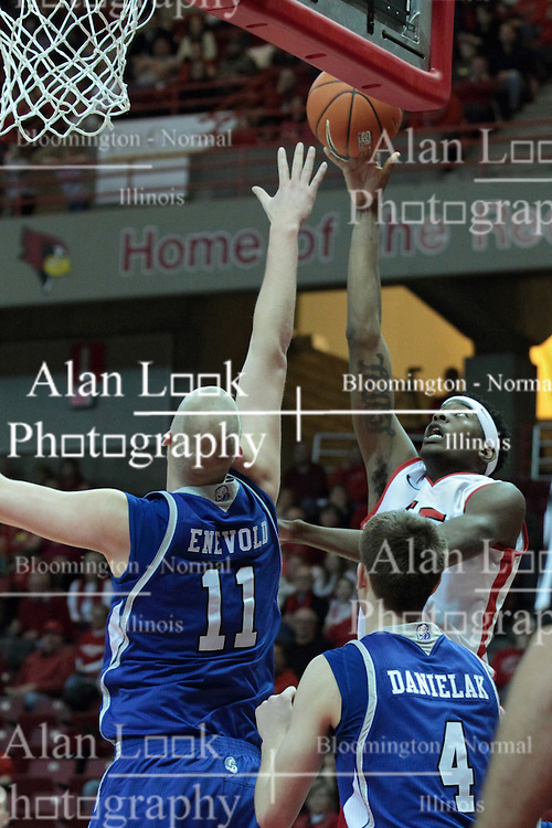 01 February 2014:  Jamaal Samuel releases a short shot over Jacob Enevold Jensen during an NCAA Missouri Valley Conference (MVC) mens basketball game between the Drake Bulldogs and the Illinois State Redbirds  in Redbird Arena, Normal IL.
