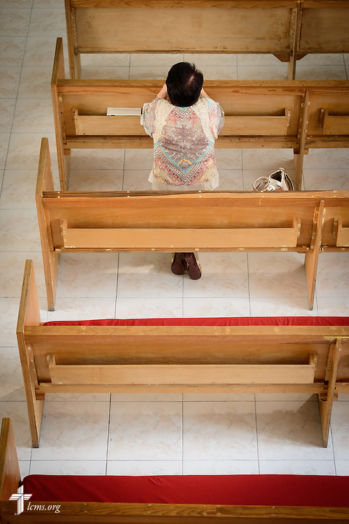 A worshipper kneels before service at the Lutheran Church of San Pedro on Sunday, Feb. 14, 2016, in Mexico City, Mexico. LCMS Communications/Erik M. Lunsford