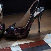 A pair of Jimmy Choo wedding shoes on a Barcelona tiled floor.