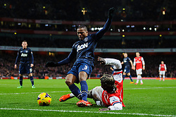 Man Utd Defender Patrice Evra (FRA) is tackled by Arsenal Defender Bacary Sagna (FRA) - Photo mandatory by-line: Rogan Thomson/JMP - 07966 386802 - 12/02/14 - SPORT - FOOTBALL - Emirates Stadium, London - Arsenal v Manchester United - Barclays Premier League.