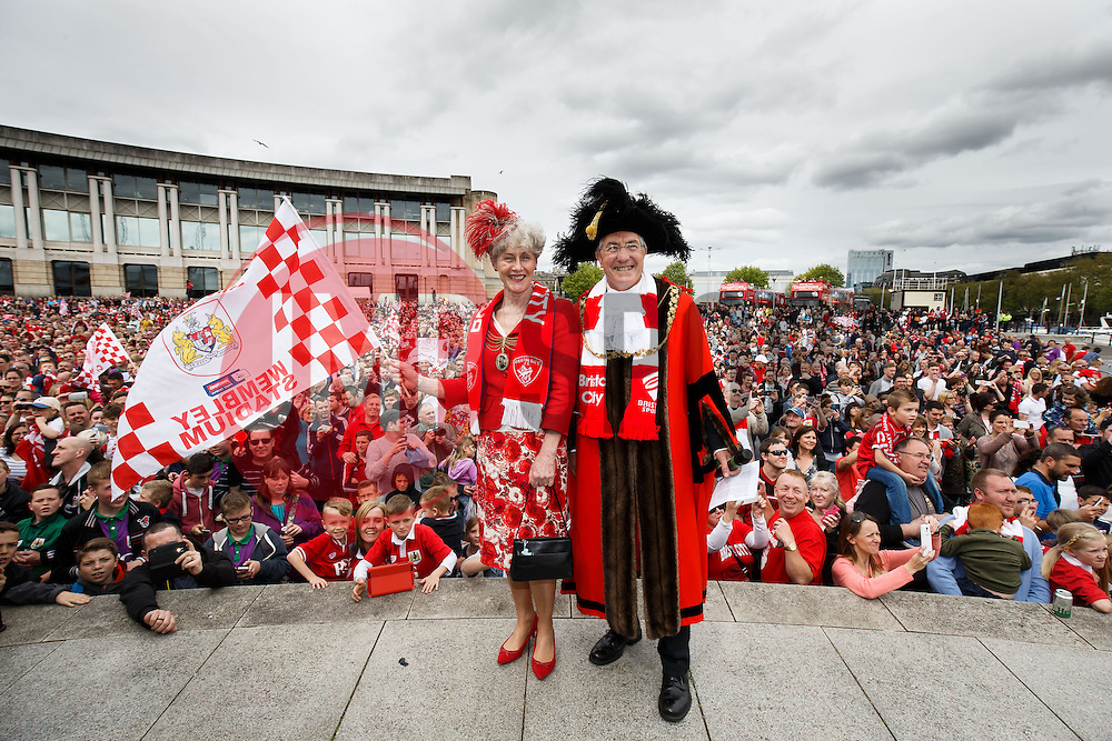 The Lord and Lady Mayor pose in front of thousands of fans at Lloyds Amphitheatre during the Bristol City open top bus parade to celebrate winning both the League 1 and Johnstone's Paint Trophy titles this season and promotion to the Championship - Photo mandatory by-line: Rogan Thomson/JMP - 07966 386802 - 04/05/2015 - SPORT - FOOTBALL - Bristol, England - Bristol City Bus Parade.