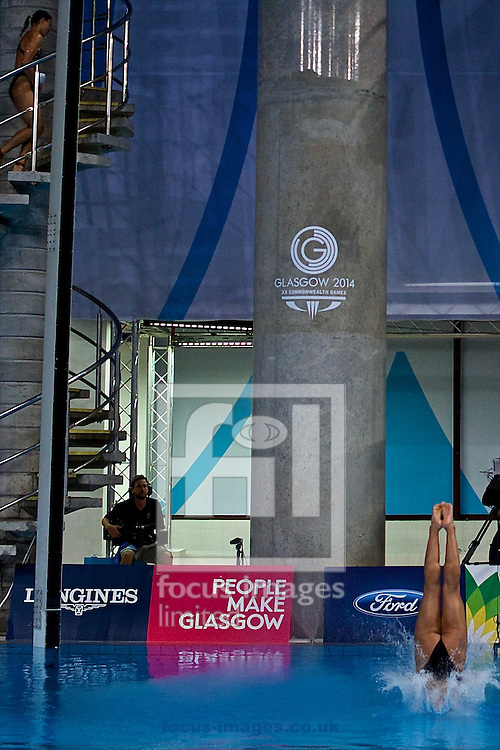 Gold medalist Meaghan Benfeito of Canada pictured entering the water at the end of her dive during the Women's 10 Metre Platform Final on Diving Day Two at Royal Commonwealth Pool during Glasgow 2014 Commonwealth Games <br /> Picture by Ian Wadkins/Focus Images Ltd +44 7877 568959<br /> 31/07/2014