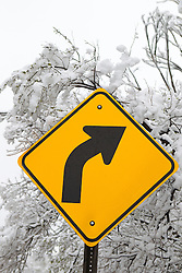 turn in the road sign in the Winter