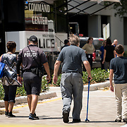 HOLLYWOOD, FL - [SEPTEMBER 13, 2017]: <br /> Hollywood Police Department officer leads relatives of patients of a rehabilitation center in the city where 6 patients died on September 12, 2017 in Hollywood, United States. (Photo by Angel Valentin/Getty Images)