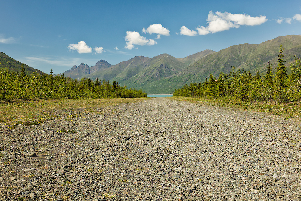 The gravel runway of Bold Airstrip at the southeast end of Eklutna Lake looking northwest towards Twin Peaks and Bold Peak in Chugach State Park in Southcentral Alaska. Summer. Afternoon.