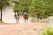 "09 SEPTEMBER 2007 -- ST. MICHAELS, AZ: Racers on the course of a two and a half mile long horse race at a traditional Navajo Horse Race in the summit area of the Navajo Indian reservation about 10 miles west of St. Michaels, AZ. Traditional horse racing is making a comeback on the Navajo reservation. The races are run on improvised courses that vary depending on the local terrain. Use of saddles is optional (except in the ""Cowhand Race"" which requires a western style saddle) and many jockeys ride bareback. The distances vary from one mile to as long as thirty miles. Traditional horse races were common until the 1950's when they fell out of favor, but there has been a resurgence in traditional racing since the late 1990's and now there is a traditional horse racing circuit on the reservation. The race was organized by the Begay family of Steamboat, AZ and run on private land about three miles from a paved road.  Photo by Jack Kurtz"