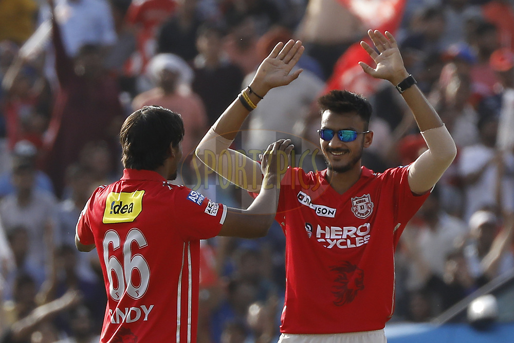 Akshar Patel of Kings XI Punjab and Sandeep Sharma of Kings XI Punjab celebrates the wicket of  Kagiso Rabada of the Delhi Daredevils during match 36 of the Vivo 2017 Indian Premier League between the Kings XI Punjab and the Delhi Daredevils  held at the Punjab Cricket Association IS Bindra Stadium in Mohali, India on the 30th April 2017<br /> <br /> Photo by Arjun Singh - Sportzpics - IPL