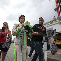 Danica Patrick exits her garage area after completing the first practice session of the 56th Annual NASCAR Coke Zero400 race at Daytona International Speedway on Thursday, July 3, 2014 in Daytona Beach, Florida.  (AP Photo/Alex Menendez)