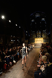 © Licensed to London News Pictures. 20/02/2016. Models on the catwalk at the JULIEN MACDONALD Autumn/Winter 2016 show. Models, buyers, celebrities and the stylish descend upon London Fashion Week for the Autumn/Winters 2016 clothes collection shows. London, UK. Photo credit: Ray Tang/LNP
