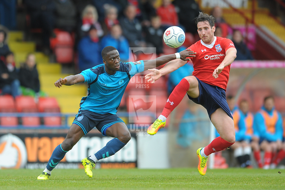 TELFORD COPYRIGHT MIKE SHERIDAN 27/4/2019 - Dan Udoh goes in for a tackle with Joe Tait of York during the Vanarama Conference North fixture between AFC Telford United and York City at Bootham Crescent