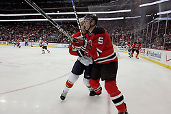 Feb 28, 2009; Newark, NJ, USA; New Jersey Devils defenseman Colin White (5) gets hit by Florida Panthers center Gregory Campbell (11) during the second period at the Prudential Center.