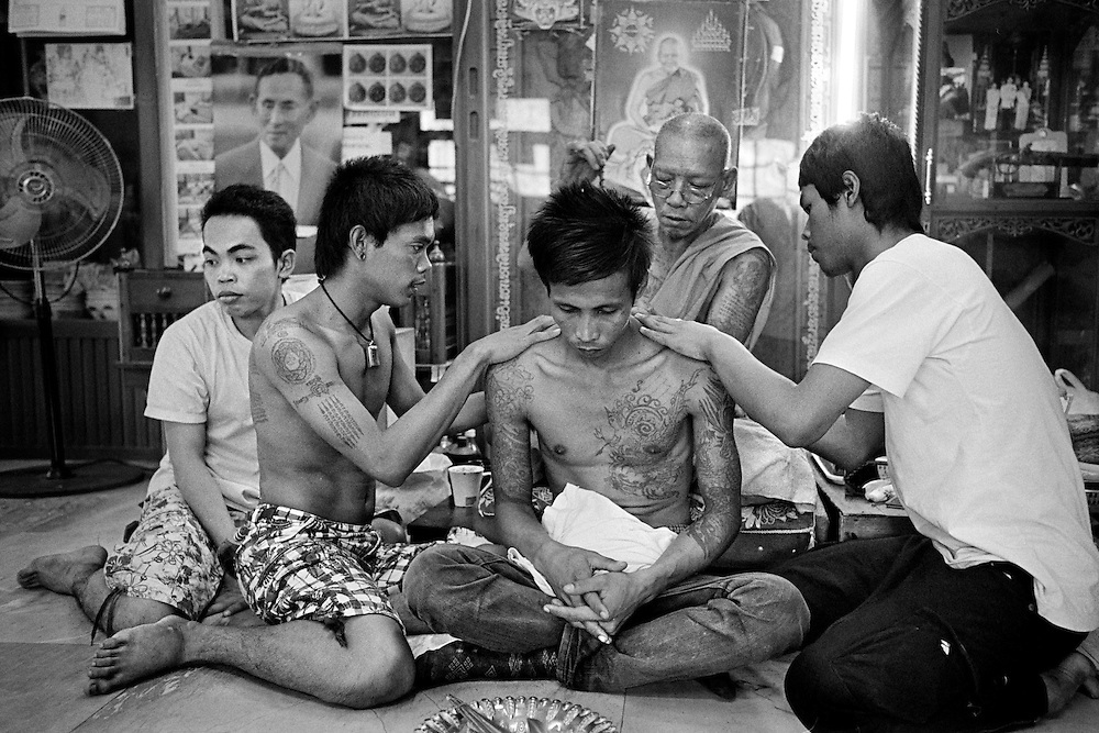 "Thailand is a deeply spiritual country, in which both superstition and ritual tattooing play an active role.   Traditional Thai tattoos are known as Yantra tattoos.  They are believed to possess strong magical powers, which will protect the bearer as well as bring him or her good luck.  With their alleged ability to break knife blades and stop bullets, this form of tattooing is particularly favoured by soldiers and the police force as well as, inevitably, by members of the underworld.<br /> <br /> Thai culture is a rich mixture of many Asiatic religious traditions.  It encompasses Hinduism, Brahmanism, Animism and Buddhism.  Whilst being ingrained in Hindu culture, Yantra tattoos, known also in Thailand as ""Sak Yant"", incorporate many elements from these other belief systems.  A further influence is taken from ancient Khmer Sanskrit texts, many of which are believed to possess magical powers. Yantra or Sak Yant tattooing is a widely practised form of sacred tattooing prevalent throughout Southeast Asia.  Adepts are to be found mainly in Cambodia, Laos and Thailand, although there is a growing interest in Singapore among Chinese Buddhists.  Sak Yant is usually performed by a ""whicha"" (magic) practitioner.  <br /> <br /> Today the best-known temple for Yant or Sak Yant tattooing is Wat Bang Phra.   This temple has an unbroken tattooing tradition dating back to the Ankor period.  The motifs and designs have evolved over the centuries, often as the result of visions received during sessions of intensive meditation.  <br /> <br /> Many Yant tattoos have been taken from images pertaining to pre-Buddhist Shamanism and its belief in multiple animal spirits. Most of these animalistic images come from the Southeast of the Asian sub-Continent and have subsequently been incorporated into Thai traditions and culture. The writing used in Yant designs is ancient Khmer"