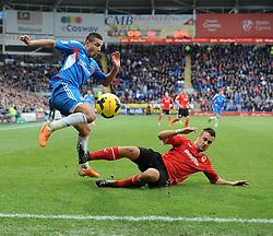 Cardiff City's Juan Cala blocks Hull City's Jake Livermore's cross   - Photo mandatory by-line: Joe Meredith/JMP - Tel: Mobile: 07966 386802 22/02/2014 - SPORT - FOOTBALL - Cardiff - Cardiff City Stadium - Cardiff City v Hull City - Barclays Premier League