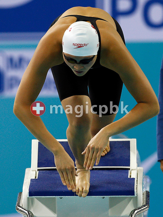 Victoria POON of Canada starts in the women's 100m Freestyle Final during the 10th FINA World Swimming Championships (25m) at the Hamdan bin Mohammed bin Rashid Sports Complex in Dubai, United Arab Emirates, Friday, Dec. 17, 2010. (Photo by Patrick B. Kraemer / MAGICPBK)