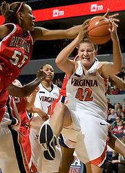 Virginia forward Kelly Hartig (42) grabs a rebound from Richmond forward/center Crystal Goring (55).  The Virginia Cavaliers women's basketball team faced the Richmond Spiders at the John Paul Jones Arena in Charlottesville, VA on November 18, 2007.