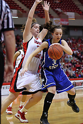 07 February 2009: Kelsie Cooley tries a spin move to get around Nicolle Lewis. Illinois State increased their 1st place lead by beating 2nd place Indiana State by a score of 69-48. The Illinois State University Redbirds hosted the Indiana State University Sycamores on Doug Collins Court inside Redbird Arena on the campus of Illinois State University in Normal Illinois