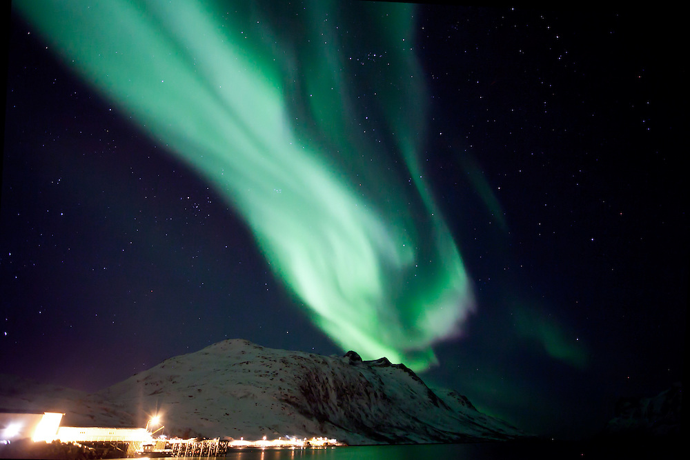 The Aurora Borealis (Northern Lights) at Ersfjordbotn in Tromso, Norway looking like a huge meteor crashing on Earth.